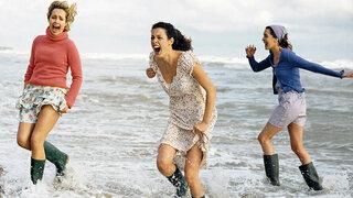 Frauen mit Gummistiefeln