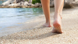 Auf Sand laufen